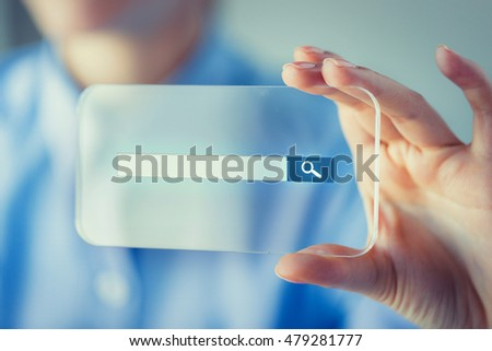 business, technology, network, web and people concept - close up of woman hand holding and showing transparent smartphone with browser search bar on screen #479281777