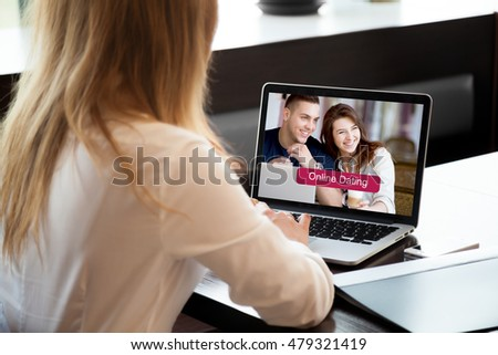 Young beautiful single woman browsing online dating website on a laptop display. Attractive woman model sitting with notebook, searching for new love on-line. Close-up. Back view. Focus on screen #479321419