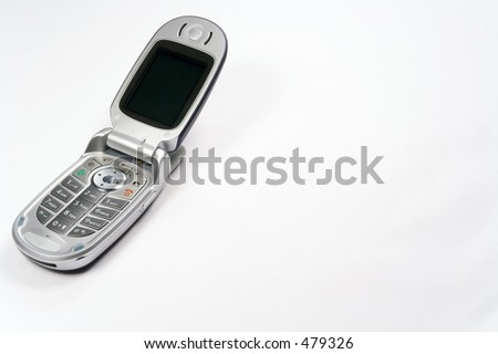 Closeup shot of open Moto V551 mobile phone (all branding removed in Photoshop) shot in studio light against a white background. Text space is present to the right of the image. Meticulously clean.
