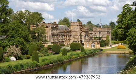 Forde Abbey mansion from its ornamental pond and formal gardens.  Chard, Somerset - June 14, 2009: The Forde Abbey mansion from beside its ornamental pond and formal gardens. #479367952