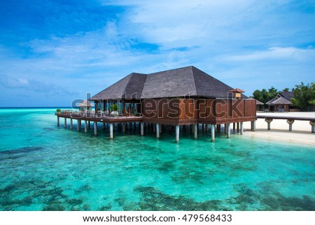 beach with water bungalows at Maldives #479568433