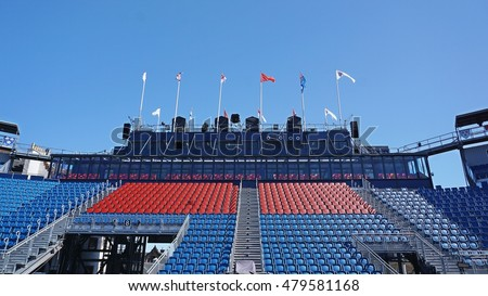 Empty grandstand against the blue sky with flag #479581168