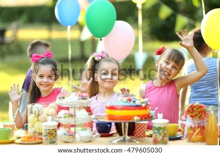 Children celebrating birthday in park #479605030