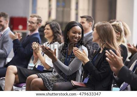 Audience Applauding Speaker After Conference Presentation Royalty-Free Stock Photo #479633347