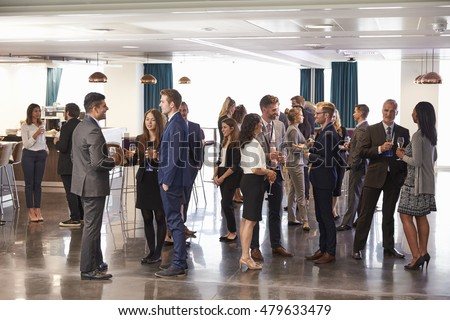Delegates Networking At Conference Drinks Reception Royalty-Free Stock Photo #479633479