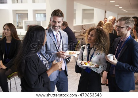 Delegates Networking During Conference Lunch Break Royalty-Free Stock Photo #479653543