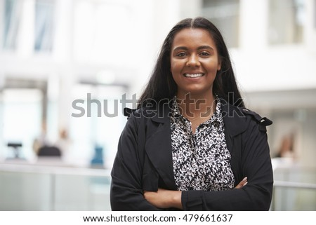 Head And Shoulders Portrait Of Young Businesswoman In Office #479661637