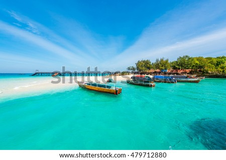 colorful exotic seascape with boats near Zanzibar shore in Africa #479712880