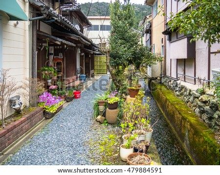 KYOTO, JAPAN - MARCH 24: Typical street on March 24, 2015 in Kyoto, Japan. Kyoto is also known as the City of Ten Thousand Shrines. #479884591