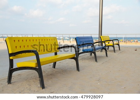three colorful benches in a rest area on the beach #479928097