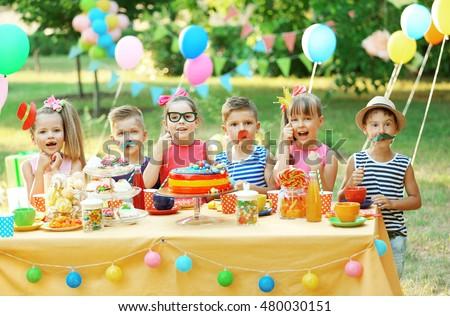 Children celebrating birthday in park #480030151
