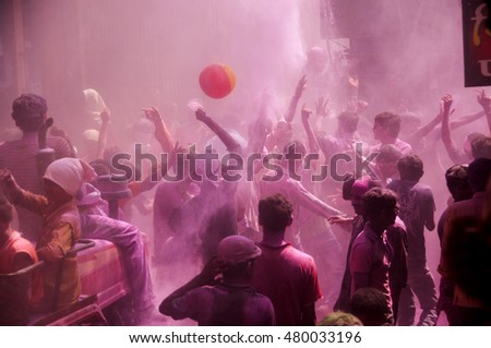 MUMBAI, INDIA -29 SEPTEMBER 2012 : People throw colors to each other and dancing during the procession of Ganesh Immersion which marks the end of the ten-day-long Ganesh Chaturthi festival. #480033196