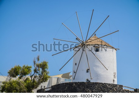 the old white mill on a bright Sunny day in Greece #480047929