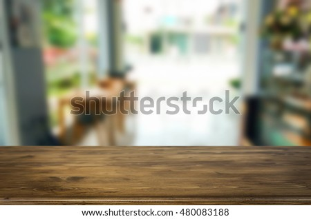 Selected focus empty brown wooden table and Coffee shop blur background with bokeh image, for product display montage. #480083188