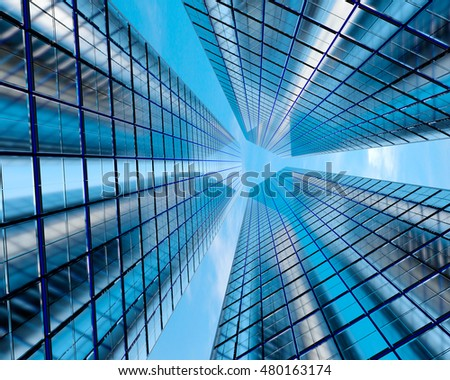 Three skyscrapers on a background of sky and clouds. 3D illustration #480163174