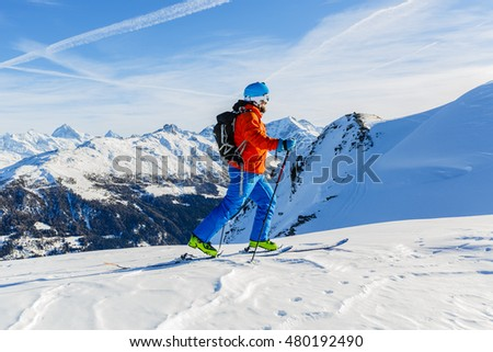 Ski touring in high mountains in fresh powder snow. Snow mountain range. Mt Fort Peak Alps region Switzerland.Wallis  #480192490