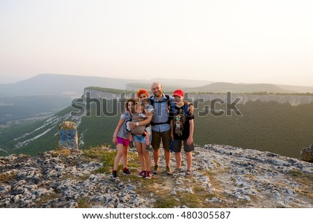 Happy big family travel together on top, peak of mountain. Traveler man and woman, father and mother with children on vacation. Beautiful nature landscape tourism, hiking. Parents with kids outdoors. #480305587