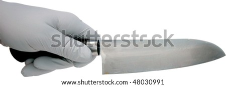 a gloved hand holds a sharp knife isolated on white with room for your text or images #48030991