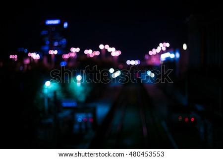 Railway Station railroad station a top view of the night lights of the city transportation rail station turnstiles Kolaiah purple, violet, violaceous, magenta, amaranthine blue color tone bokeh blur #480453553