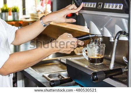 Women with coffee machine in shop Thailand. #480530521