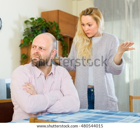 Unpleased man and young angry woman having quarrel at home  #480544015