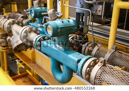 Flow transmitter or Flow transducer equipment function and sent PLC logic to processor in oil and gas production process,Electronic device in oil and gas industry and equipment under maintenance mode. Royalty-Free Stock Photo #480552268