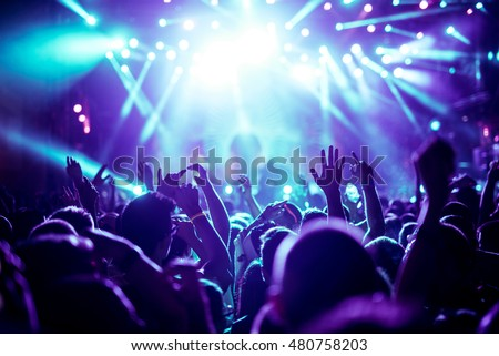 Crowd raising their hands and enjoying great festival party. Royalty-Free Stock Photo #480758203