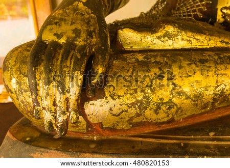 Close up hand of Buddha with gold plate stick #480820153