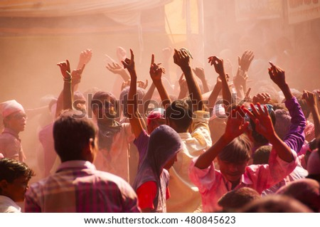 MUMBAI, INDIA -29 SEPTEMBER 2012 : People throw colors to each other and dancing during the procession of Ganesh Immersion which marks the end of the ten-day long Ganesh Chaturthi festival. #480845623