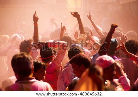 MUMBAI, INDIA -29 SEPTEMBER 2012 : People throw colors to each other and dancing during the procession of Ganesh Immersion which marks the end of the ten-day long Ganesh Chaturthi festival. #480845632