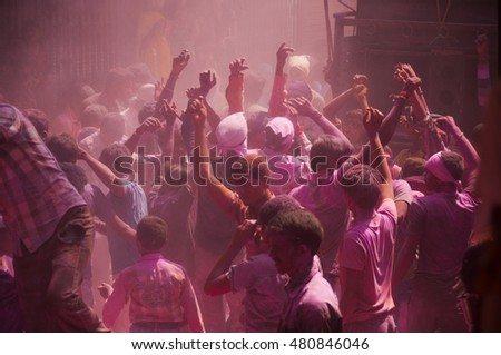 MUMBAI, INDIA -29 SEPTEMBER 2012 : People throw colors to each other and dancing during the procession of Ganesh Immersion which marks the end of the ten-day long Ganesh Chaturthi festival. #480846046