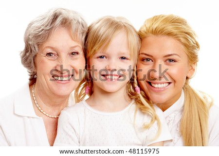Faces of grandmother with adult daughter and grandchild in line #48115975