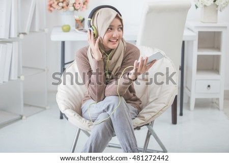 portrait of beautiful asian woman enjoying music #481272442