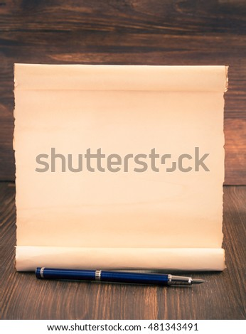 parchment scroll on wooden background #481343491