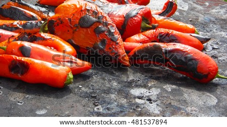 red roasted sweet peppers on a open oven plate #481537894
