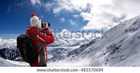 Photographer overlooking winter landscape