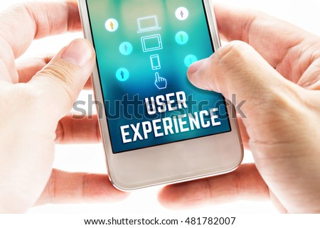 Two hand holding mobile with user experience and icon on blur screen,Online Digital business concept.