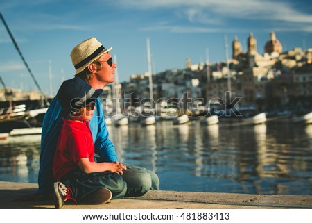 father and son looking at city of Valetta, Malta #481883413