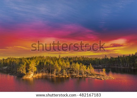Colorful surrealistic landscape with dramatic beautiful vivid sky at sunset golden hour. Nature of Northern Europe or America. #482167183