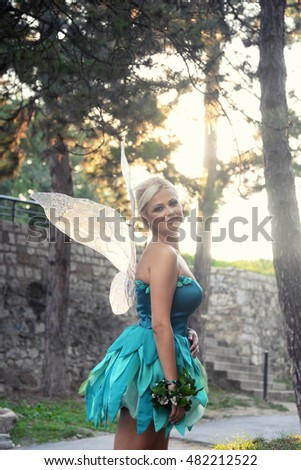 Tinker Bell. Girl dressed as a fairy tale of Peter Pan