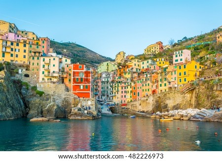 Riomaggiore village lit during sunset in Cinque terre, Italy. #482226973