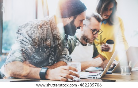 Group Young Business People Gathered Together Discussing Creative Idea Cafe.Startup Concept Coworkers Meeting.Brainstorming Work Process Office.Using Modern Electronics Gadgets.Blurred Background #482235706