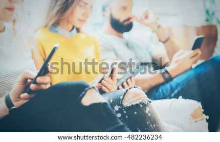 Closeup Group Adult Hipsters Friends Sitting Sofa Using Modern Gadgets.Business Startup Friendship Teamwork Concept.Creative People Working Together Project.Coworking Process Inside Studio.Blurred #482236234