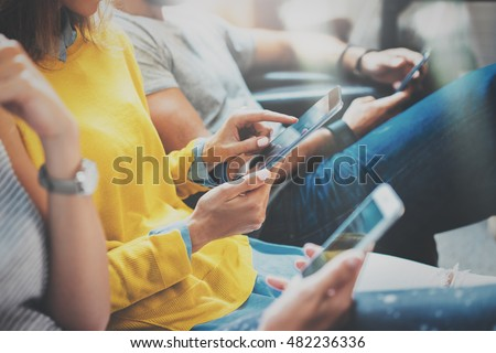 Closeup Group Hipsters Friends Sitting Sofa Using Modern Tablet.Business Startup Friendship Teamwork Concept.Creative People Working Together Digital Gadgets.Coworking Process Office Studio.Blurred #482236336