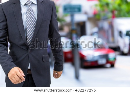 isolated business man walking on the street  #482277295