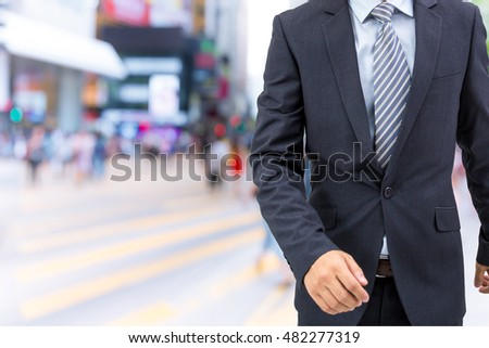 isolated business man walking on the street  #482277319