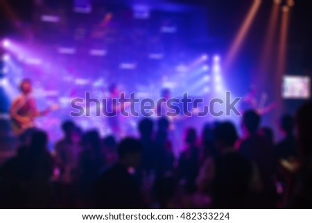 Blur image of a crowd of people at a concert live show on stage. #482333224
