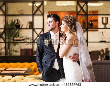 stylish luxury wedding couple hugging #482629963