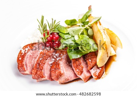 Roast goose breast on white plate #482682598