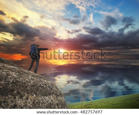 Tourist in mountains. Traveler on a mountain top #482757697